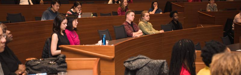 People seated in lecture hall